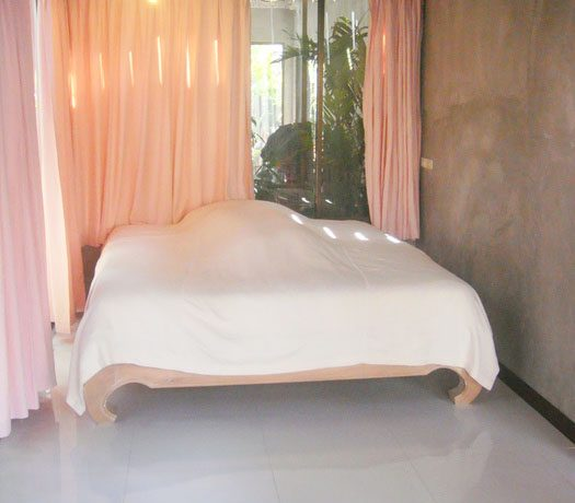 a_bedroom_at_this_classical_teakwood_house_in_pattaya_centre_1