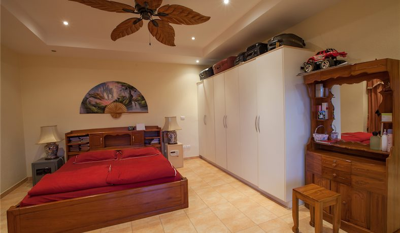 a_bedroom_at_this_very_roomy_pool_villa_with_gorgeous_sea_views_1