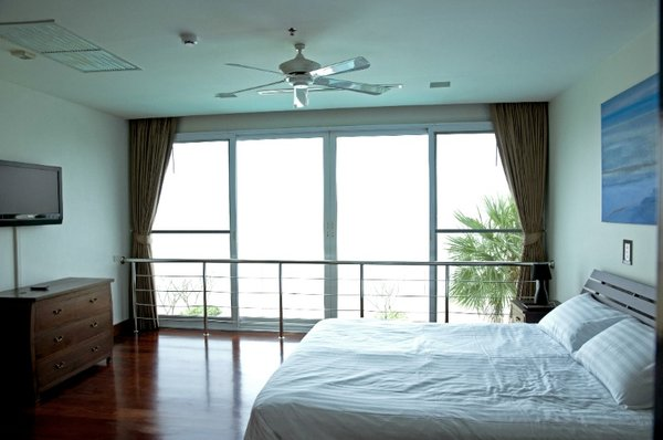 a_bedroom_of_this_2_bed_5_star_beachfront_condo__naklua_1