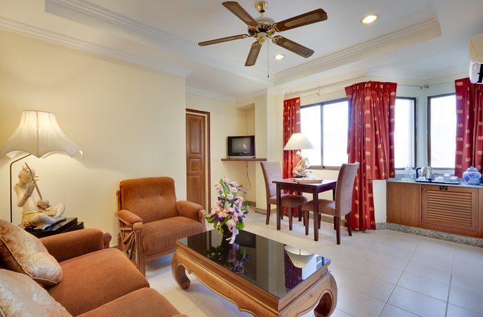a_suite_room_with_kitchenette_and_dining_area_1