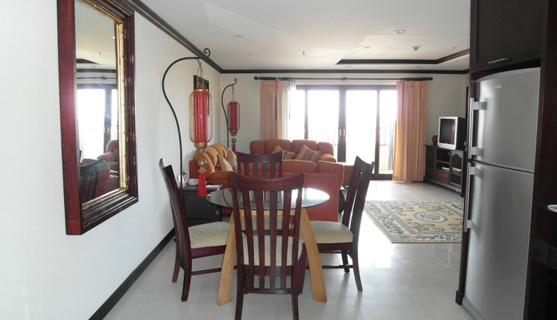 another_view_of_the_living_room_at_106_sqm_condo_at_nirvana_residence_1
