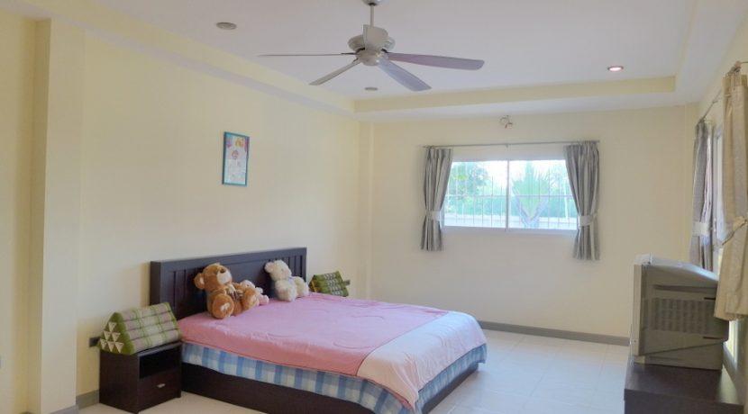 generous_bedroom_with_tv_1