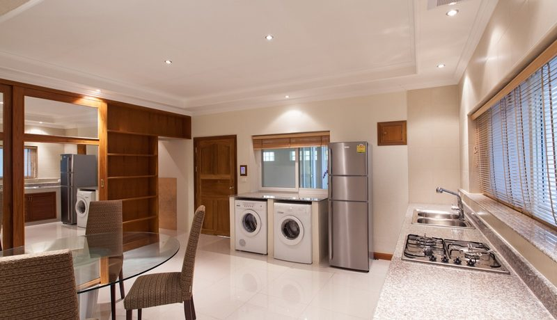 kitchen_with_fridge_and_laundry_machine_1