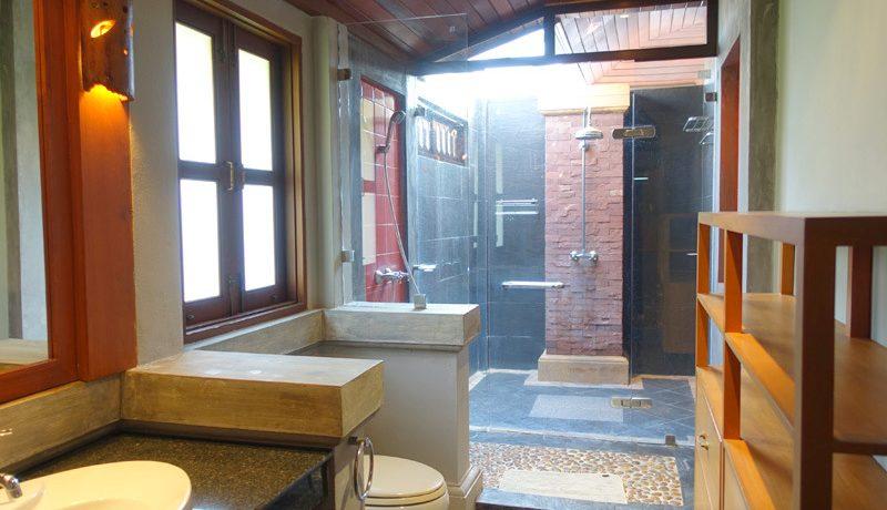 lavish open-plan kitchen with top equipment