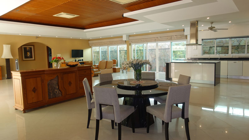 Dining-area_with_open-plan_kitchen